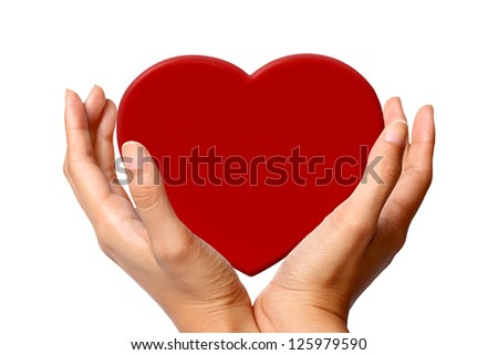 Hands Presenting Heart - stock photo