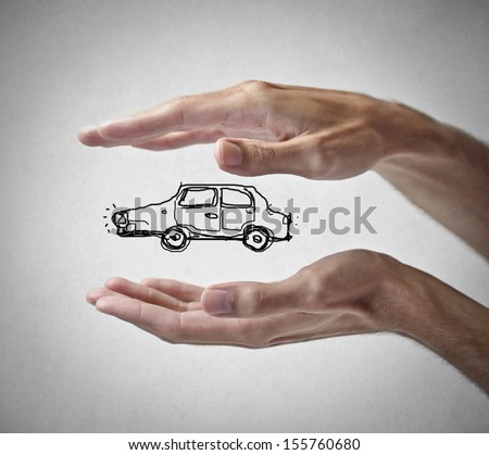 hands protecting a car - stock photo