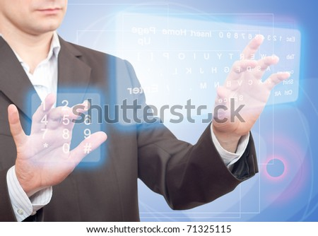 Hands pushing a button on a touch screen. Two Virtual Keyboard. - stock photo