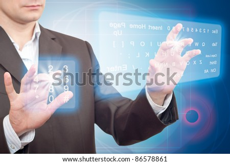 Hands pushing a button on a touch screen. Two Virtual Keyboard - stock photo