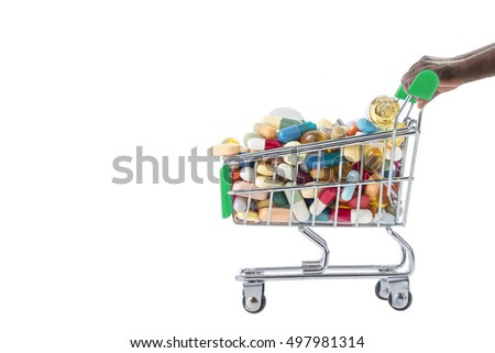 Hands pushing supermarket trolleys filled with pills