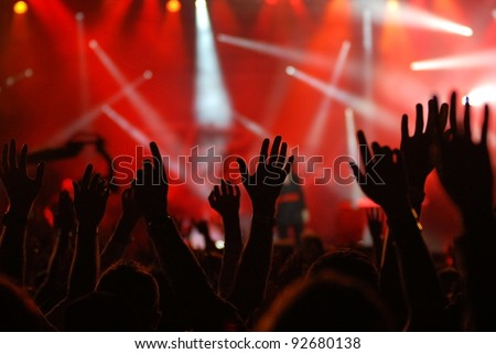 hands raised at rock concert - stock photo