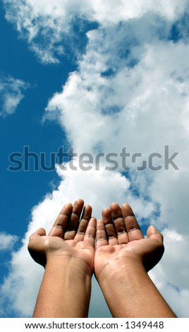 Hands raised unto the heavens as if in a gesture of spiritual supplication - stock photo