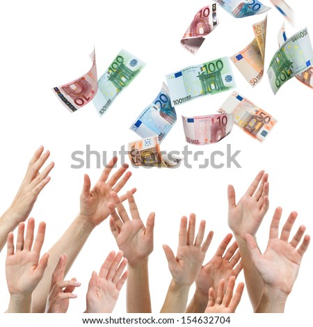 Hands reaching for Euro money flying in the air - stock photo