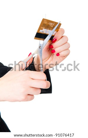 Hands ready to scissor a credit card. Isolated over white - stock photo