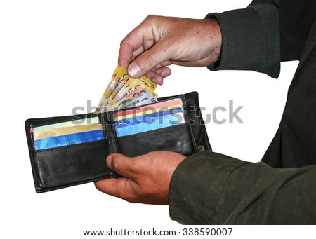 Hands removing miniature Australian money from wallet with credit cards. With clipping path. Shrinking Australian dollar, reduced bills, low income, debt concept.