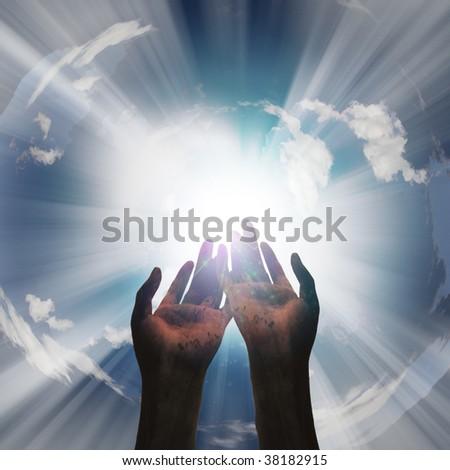 Hands reveal light - stock photo