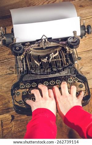 Hands secretary, writing on an old typewriter. - stock photo