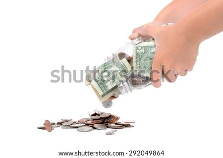 hands shaking money out of glass jar isolated on white background
