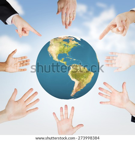 Hands showing against blue sky - stock photo