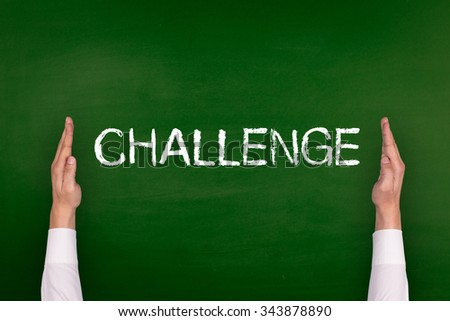 Hands Showing CHALLENGE on Blackboard - stock photo