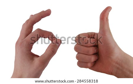 Hands showing OK and thumb up on white background - stock photo