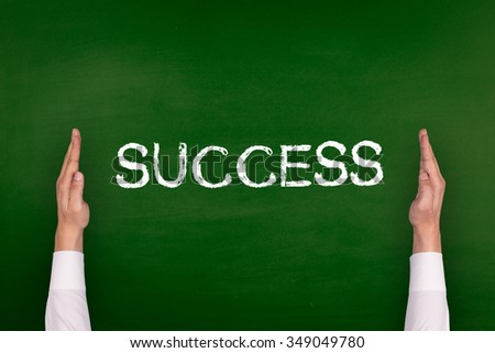 Hands Showing SUCCESS on Blackboard - stock photo