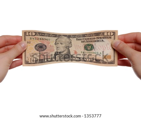 Hands Stretching New $10 Bill on White Background - stock photo