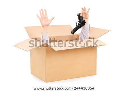 Hands surrendering gun and peeking from a box isolated on white background  - stock photo