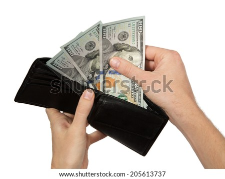 Hands taking money from open wallet