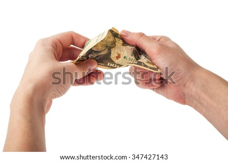 Hands tear money