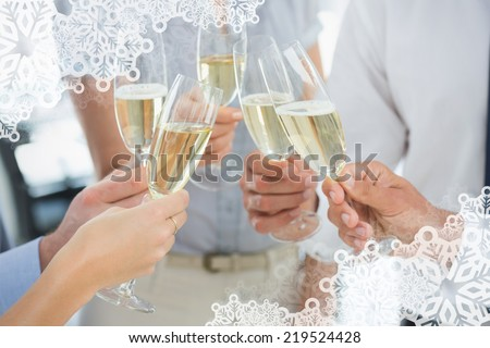 Hands toasting with champagne against snowflake frame - stock photo