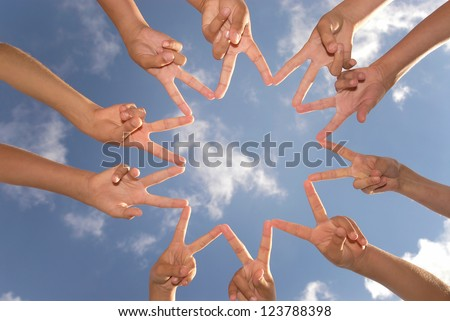 Hands together against the sky - stock photo