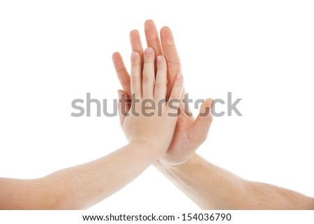 Hands together. Close-up of child and adult hand touching each other while isolated on white - stock photo