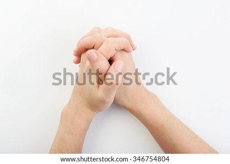 hands together resting on top of a  white plain background