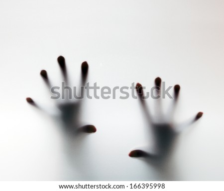 Hands touching frosted glass. Conceptual scream for help, depression, stress, panic - stock photo