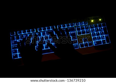 hands typing computer keys during work - stock photo