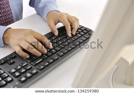 Hands typing on keyboard. This is office environment concept