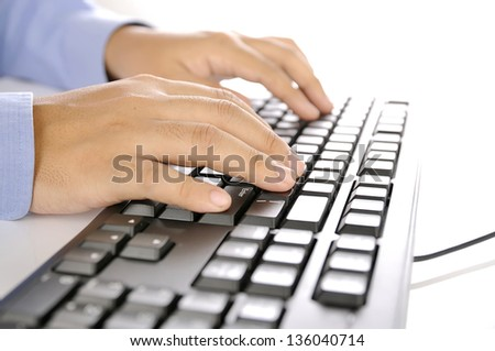 Hands typing on keyboard. This is office environment concept - stock photo