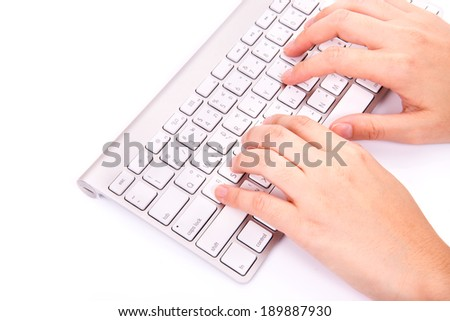 Hands typing on the remote wireless computer keyboard in white background - stock photo