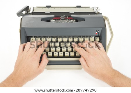 hands typing on writing machine - stock photo