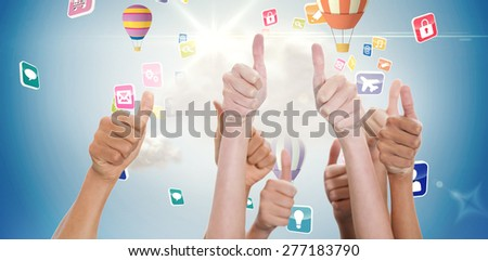 Hands up and thumbs raised against cloud computing graphic with hot air balloons - stock photo