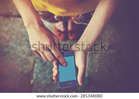 hands using a phone texting on smartphone app - stock photo