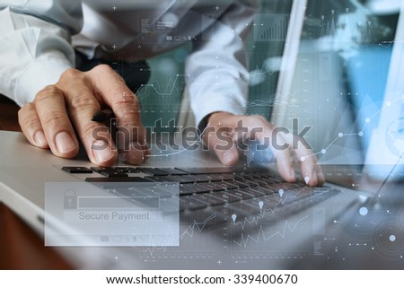 "hands using laptop and holding credit card with ""Secure payment"" on the screen as Online shopping concept - stock photo"