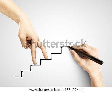 hands walking on drawing stairs