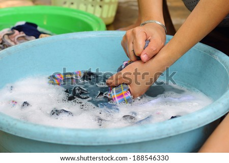 hands wash in enameled bowl close up - stock photo