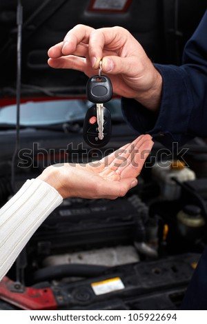 Hands with a Car keys. Auto repair service. - stock photo
