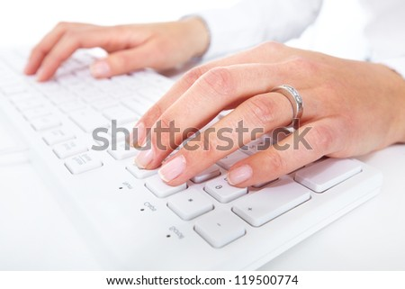 Hands with a computer keyboard. Technology background. - stock photo