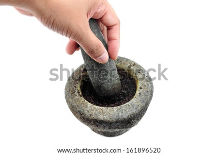 hands with a pestle and mortar on white - stock photo