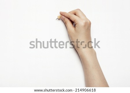 hands with a pin isolated white.