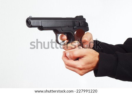 Hands with army gun on a white background - stock photo