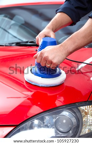 Hands with Auto polisher. Car repair service. - stock photo
