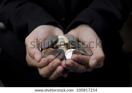 Hands with baht coins