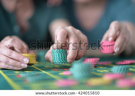 hands with  casino chips  - stock photo