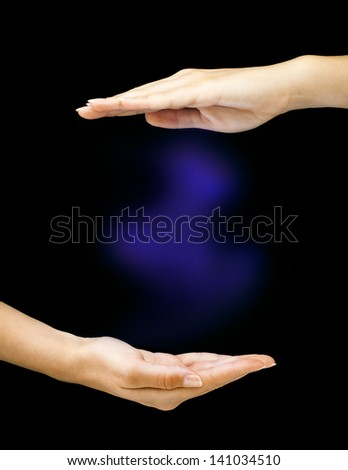 Hands with colored mist - stock photo