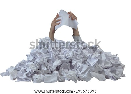 Hands with empty crushed paper reaches out from crumpled papers