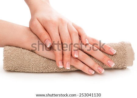 Hands with french manicure on towel