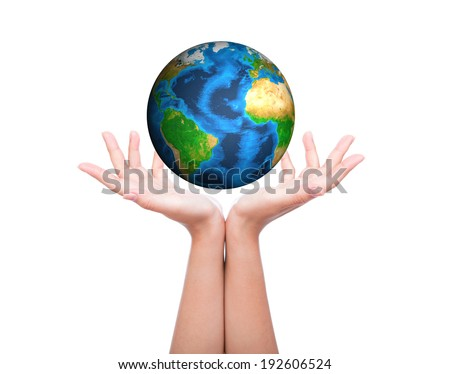 Hands with green earth (Elements of this image furnished by NASA) - stock photo