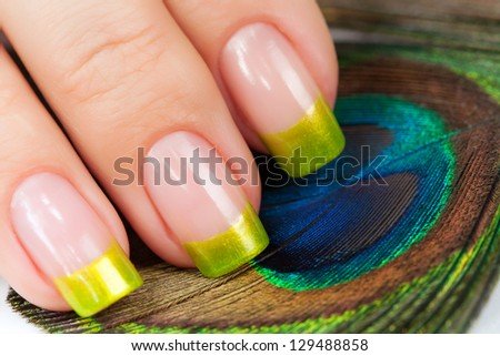 Hands with green manicure - stock photo