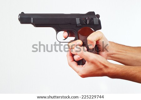 Hands with gun on a white background - stock photo